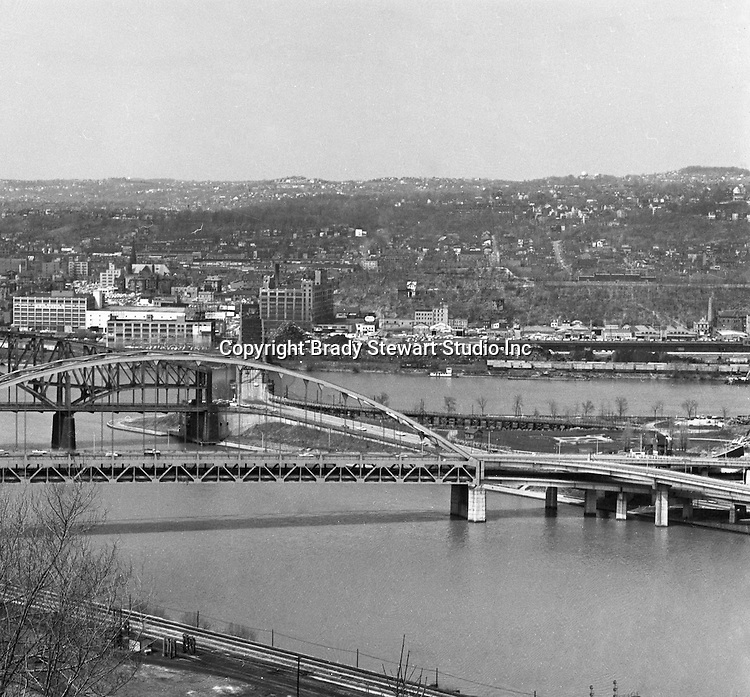 Pittsburgh PA:  View of the Point bridges, Fort Pitt, Point and Manchester - 1962