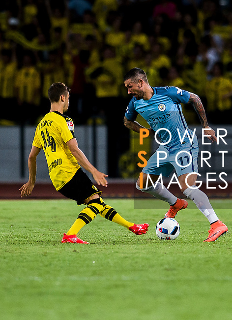 Manchester City defender Aleksandar Kolarov (r) tries to dribble Borussia Dortmund midfielder Moritz Leitner (l) during an attack of City against Borussia Dortmund at the 2016 International Champions Cup China match at the Shenzhen Stadium on 28 July 2016 in Shenzhen, China. Photo by Marcio Machado / Power Sport Images