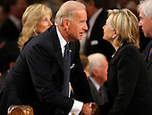 Boston, MA - August 29, 2009 -- Vice President Joseph Biden talks with Secretary of State Hillary Clinton (R). during funeral services for U.S. Senator Edward Kennedy at the Basilica of Our Lady of  Perpetual Help in Boston, Massachusetts August 29, 2009.  Senator Kennedy died late Tuesday after a battle with cancer. .Credit: Brian Snyder- Pool via CNP