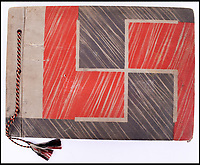 BNPS.co.uk (01202 558833)<br /> Pic: C&amp;TAuctions/BNPS<br /> <br /> Eva Brauns album features a swastika cover with themed red, white and black tassels.<br /> <br /> A photo album containing never-before-seen candid snaps of Adolf Hitler that was found in Eva Braun's bedroom drawer in the Fuhrer's Bunker has sold for more than &pound;41,000.<br /> <br /> The remarkable images show the Nazi dictator and his henchmen in rare lighter moments of the Second World War.<br /> <br /> The album, which was unearthed after 72 years, sparked fervent interest and attracted a phone bid of more than double its estimate of &pound;18,000.<br /> <br /> The hammer price was &pound;34,000, with extra fees pushing the final total to &pound;41,140.<br /> <br /> There is one snap of a grinning Hitler in a 'Chaplinesque' pose and offering a playful salute to the person taking the photo outside his Berghof headquarters. Two more show him smiling in front of a crowd of children saluting him.