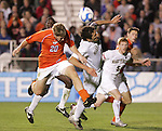 14 December 2007: Virginia Tech's James Gilson (20) and Wake Forest's Julian Valentin (4) challenge for a header. The Wake Forest University Demon Deacons defeated the Virginia Tech University Hokies 2-0 at SAS Stadium in Cary, North Carolina in a NCAA Division I Men's College Cup semifinal game.