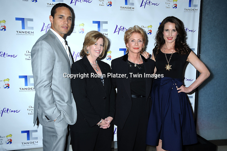 """actor Daniel Sunjata, President and CEO of AETN Network Abbe Raven, Patricia Cornwell and  Andie MacDowell posing for photographers at The Lifetime Television screening of Patricia Cornwell's novel """"The Front"""" starring Daniel Sunjata, Andie MacDowell and Ashley Williams at The Hearst Tower on April 7, 2010. The movie airs on April 10, 2010."""