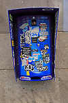 Condom machine covered in labels and graffiti, Madrid city centre, Spain