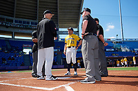 Michigan Wolverines head coach Erik Bakich (23) and  Army head coach Jim Foster during the lineup exchange with umpires Kyle Reese (left hidden), Mark Spicer, and Bob Lothian before a game on February 17, 2018 at Tradition Field in St. Lucie, Florida.  Army defeated Michigan 4-3.  (Mike Janes/Four Seam Images)