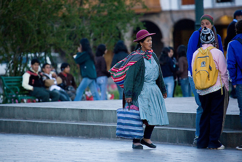 THE YOUNG AND THE OLD ARE CONTRASTED IN MODERN DAY CUZCO PERU