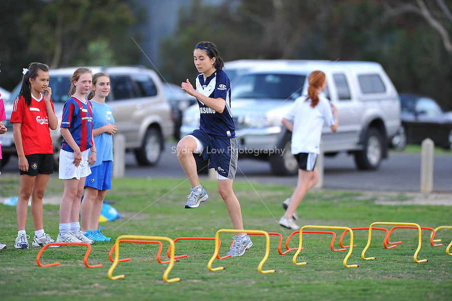 MELBOURNE, AUSTRALIA - Dec 4, 2009. Players from the Central City FC U15 girls team at a training session on running technique. Photo Sydney Low www.syd-low.com