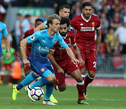 27th August 2017, Anfield, Liverpool, England; EPL Premier League football, Liverpool versus Arsenal; Nacho Monreal of Arsenal shields the ball from Mohammed Salah of Liverpool