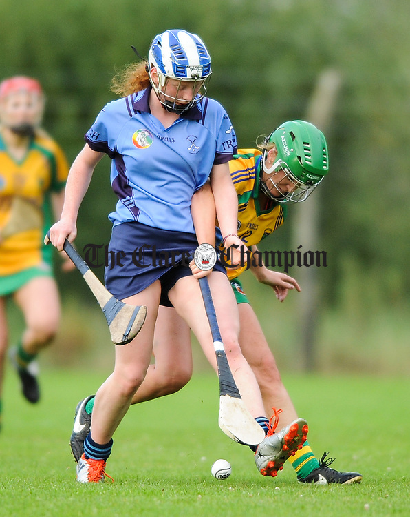 Roisin Powell of Truagh-Clonlara in action against Marie O Halloran of Inagh-Kilnamona during their first round senior championship game in Shannon. Photograph by John Kelly