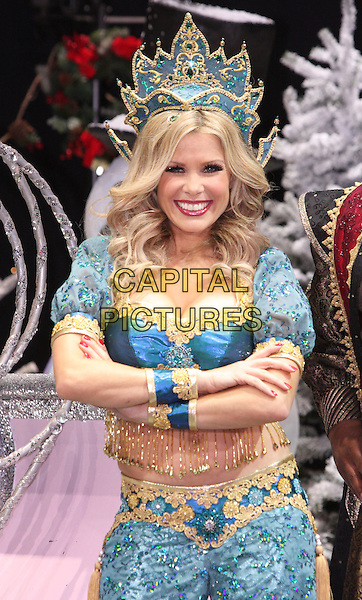 MELINDA MESSENGER.First Family Entertainment 2011 Pantomimes Photocall at the Piccadilly Theatre, London, November 26th 2010..panto costume half length genie blue turquoise beaded bra top trousers harem  tassels midriff tummy stomach crop cropped crown arms folded crossed smiling .CAP/JIL.©Jill Mayhew/Capital Pictures