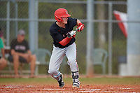 Ball State Cardinals shortstop Noah Powell (3) bunts during a game against the Saint Joseph's Hawks on March 9, 2019 at North Charlotte Regional Park in Port Charlotte, Florida.  Ball State defeated Saint Joseph's 7-5.  (Mike Janes/Four Seam Images)