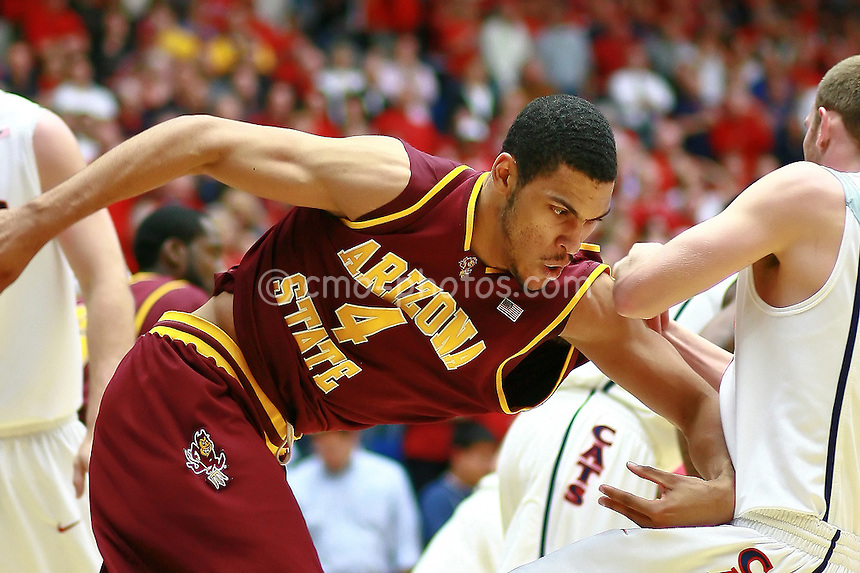 Jan 21, 2009; Tucson, AZ, USA; Arizona State Sun Devils forward Jeff Pendergraph (4) runs into Arizona Wildcats guard Zane Johnson (right) during the first half of a game at the McKale Center.  The Sun Devils won the game 53-47.