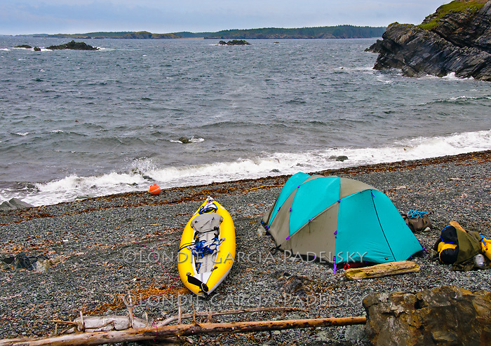 Tent and kayak on Shuyak Island, Shuyak Island State Park, an island in the northern part of Kodiak Archipelago, Alaska