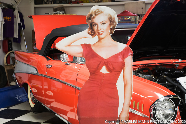 A life size cutout of Marilyn Monroe standing beside a 1957 Chevy convertible reminds visitors of the  sixties at the Route 66 Museum in Santa Rosa, New Mexico