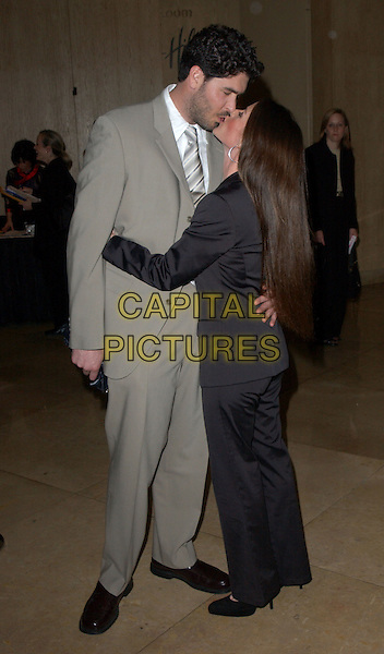 "SOLEIL MOON FRYE & JASON GOLDBERG.The Alzheimer's Association's 12th Annual ""A Night at Sardi's"" Celebrity Fundraiser held at The Beverly Hilton Hotel in Beverly Hills, California .04 March 2004.*UK Sales Only*.full length, full-length, kissing.www.capitalpictures.com.sales@capitalpictures.com.©Capital Pictures."