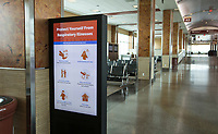 A video board displays reminders for slowing the spread of covid-19 Wednesday, May 13, 2020, in a mostly empty concourse at Northwest Arkansas National Airport in Highfill. Go to nwaonline.com/200517Daily/ to see more photos.<br /> (NWA Democrat-Gazette/Ben Goff)