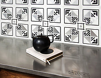 Tuileries Petite, a hand-cut mosaic, shown in polished Thassos, Nero Marquina, and brushed Aluminum, is part of the Jardins Fran&ccedil;ais&trade; collection by Caroline Beaupere for New Ravenna.<br />