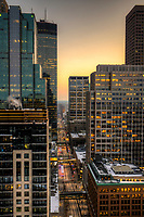Minneapolis, Minnesota skyline at sunset as seen from the 30th floor of the 365 Nicollet apartment tower.