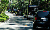The motorcade carrying United States President Barack Obama travels up South Road in Chilmark, Massachusetts on the island of Martha's Vineyard on Wednesday, August 14, 2013. President Obama and family are vacationing on the island for the week.  <br /> Credit: Matthew Healey / Pool via CNP