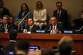 United States President Barack Obama attends a meeting of the Open Government Partnership at the United Nations 69th General Assembly at U.N. Headquarters in New York, New York on Wednesday, September 24, 2014. At left is President Enrique Peña Nieto of Mexico.<br /> Credit: Allan Tannenbaum / Pool via CNP