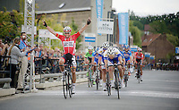 winner Jonas van Genechten (BEL/Lotto-Belisol) crossing the finish line victoriously<br /> <br /> 54th Druivenkoers 2014<br /> Huldenberg - Overijse (Belgium): 196km