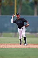 GCL Marlins shortstop Nasim Nunez (1) throws to first base during a Gulf Coast League game against the GCL Astros on August 8, 2019 at the Roger Dean Chevrolet Stadium Complex in Jupiter, Florida.  GCL Marlins defeated GCL Astros 5-4.  (Mike Janes/Four Seam Images)