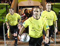 Referee Crawford Allan leads the teams out in the St Mirren v Hamilton Academical Scottish Communities League Cup match played at St Mirren Park, Paisley on 25.9.12.