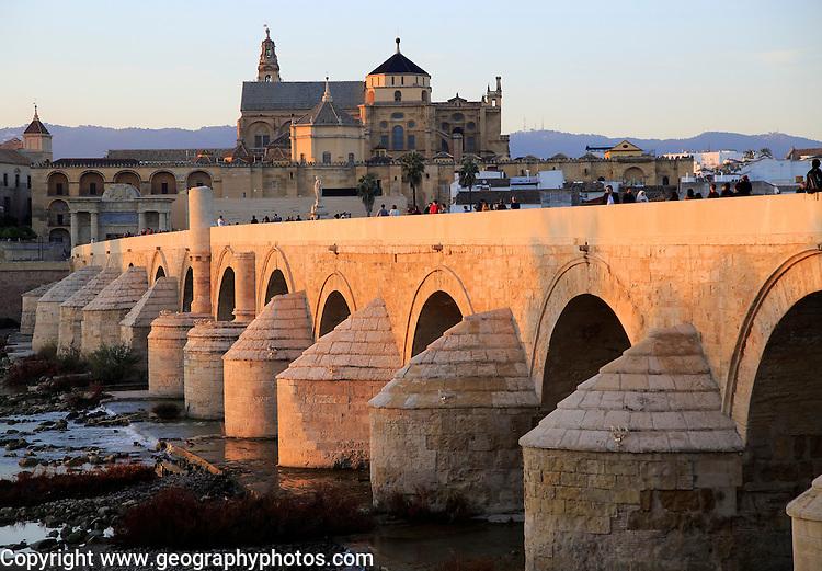 Roman bridge spanning river Rio Guadalquivir with Mezquita buildings, Cordoba, Spain