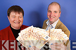 WINNER: Eileen OConnor from Dingle receives her 1,000 cash prize from Kerrys Eye financial controller, Tom MacMahon.