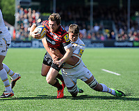Alex Goode of Saracens is tackled by Mike Williams of Worcester Warriors during the Aviva Premiership match between Saracens and Worcester Warriors at Allianz Park on Saturday 3rd May 2014 (Photo by Rob Munro)