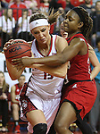 VERMILLION, SD - MARCH 27, 2016 -- Kelly Stewart #15 of South Dakota protects the ball from  Ima Akpan #20 of Western Kentucky during their WNIT game Sunday evening at the Dakotadome in Vermillion, S.D.  (Photo by Dick Carlson/Inertia)
