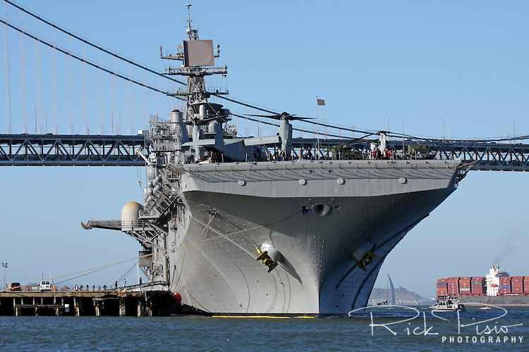 The Wasp Class Amphibious Assault Ship USS Bonhomme Richard (LHD-6) docked along the San Francisco waterfront. The Bonhomme Richard was named in honor of John Paul Jones' frigage which he had named in honor of Benjamin Franklin. The Bonhomme Richard's keel was laid down on April 18, 1995, she was launched on March 14, 1997, delivered to the Navy on  May 12 of 1998, and commissioned on August 15, 1998.