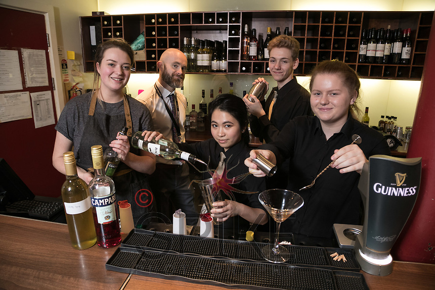 The Ruddington Arms Mixologist Grace Bond (left) creates some great cocktails with students Marianne Loa (centre) and Sophie Scroggie (right), whilst restaurant manager Chris Stamp and student Jamie Edwards-Elvidge stand behind at the pub's Takeover Evening at the Adams Restaurant, Nottingham