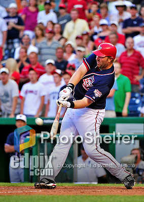 3 July 2010: Washington Nationals first baseman Adam Dunn hits a game-reviewed 2-RBI double to tie the game in the bottom of the 9th inning against the New York Mets at Nationals Park in Washington, DC. The Nationals then rallied to defeat the Mets 6-5 in the third game of their 4-game series. Mandatory Credit: Ed Wolfstein Photo
