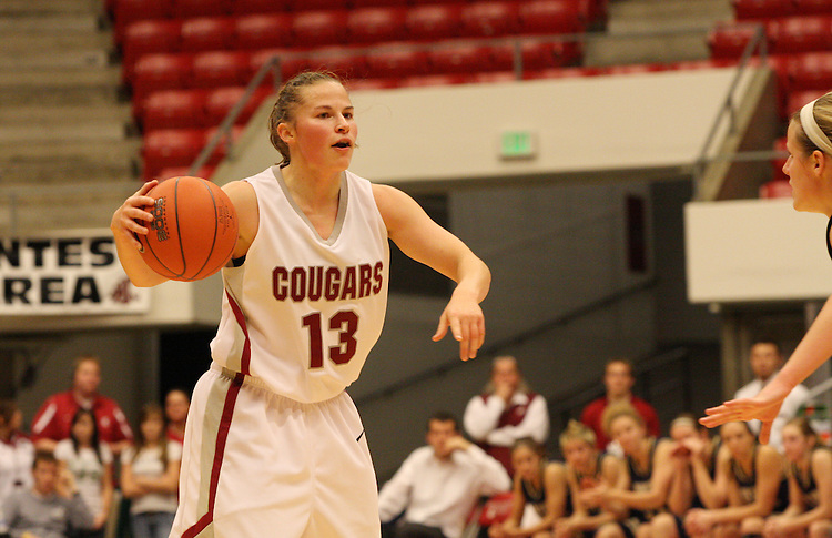 Katie Appleton (#13), Washington State senior guard, directs the offense during the Cougars game against Montana State in Pullman, Washington, on November 23, 2008.  The Cougars prevailed in the contest, 78-66.