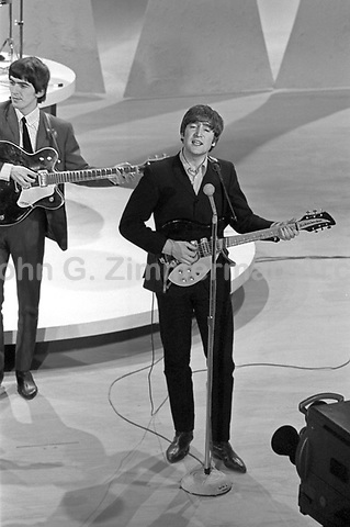 Beatles' John Lennon and George Harrison perform on Ed Sullivan Show, Feb 1964, New York City. Photographer John G. Zimmerman. C1-10.