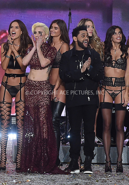 www.acepixs.com<br /> <br /> November 30 2016, New York City<br /> <br /> Lady Gaga and The Weeknd on the runway during the Victoria's Secret Fashion Show on November 30, 2016 in Paris, France.<br /> <br /> By Line: Alain Benainous/ACE Pictures<br /> <br /> <br /> ACE Pictures Inc<br /> Tel: 6467670430<br /> Email: info@acepixs.com<br /> www.acepixs.com