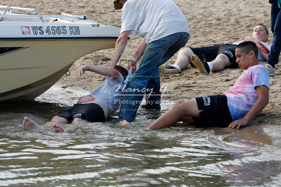 Mulitple boating accident victims on a beach in Wisconsin