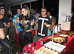 October 31st 2013   Exclusive <br /> <br /> <br /> Alessandra Ambrosio eating a hamburger at the Maroon 5 Halloween Party at the Saddle Peak Lodge in Calabasas California. Ambrosio was wearing a tight leather guitar shaped costume with black feathers around her neck &amp; tight pants. <br /> <br /> <br /> AbilityFilms@yahoo.com<br /> 805 427 3519<br /> www.AbilityFilms.com