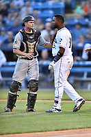 Asheville Tourists first baseman Luis Castro (31) is being held back by Arden Pabst (25) after being hit in the head by a pitch during a game against the West Virginia Power at McCormick Field on May 10, 2017 in Asheville, North Carolina. The Tourists defeated the Power 4-3. (Tony Farlow/Four Seam Images)