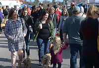 NWA Democrat-Gazette/ANDY SHUPE<br /> A large crowd walks Saturday, March 31, 2018, while enjoying the Fayetteville Farmers' Market on the Fayetteville square. The market has returned to the square for the season and is open 7 a.m. to 1 p.m. Tuesdays and Thursdays and 7 a.m. to 2 p.m. on Saturdays.