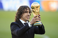 Carles Puyo lifts the World Cup trophy before kick off