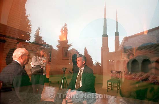 Utah media interview LDS prophet Gordon B. Hinckley at the LDS Temple. Trent Nelson reflected in window.<br />