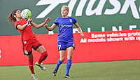 Portland, OR - Saturday July 30, 2016: Nadia Nadim, Elli Reed during a regular season National Women's Soccer League (NWSL) match between the Portland Thorns FC and Seattle Reign FC at Providence Park.