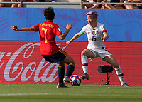 REIMS,  - JUNE 24: Marta Corredera #7 defends Megan Rapinoe #15 during a game between NT v Spain and  at Stade Auguste Delaune on June 24, 2019 in Reims, France.