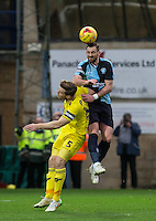 Paul Hayes of Wycombe Wanderers beats Johnny Mullins of Oxford United in the air during the Sky Bet League 2 match between Wycombe Wanderers and Oxford United at Adams Park, High Wycombe, England on 19 December 2015. Photo by Andy Rowland.