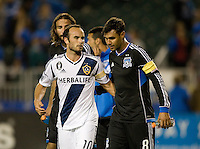 Landon Donovan of Galaxy hugs Chris Wondolowski of Earthquakes after the game at Buck Shaw Stadium in Santa Clara, California on November 7th, 2012.   LA Galaxy defeated San Jose Earthquakes, 3-1.