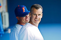 June 11, 2011:    Florida Gators head basketball coach Billy Donovan talks in the dugout with baseball head coach Kevin O'Sullivan prior to the start of NCAA Gainesville Super Regional Game 2 action between Florida Gators and Mississippi State Bulldogs played at Alfred A. McKethan Stadium on the campus of Florida University in Gainesville, Florida.   Mississippi State defeated Florida 4-3.........