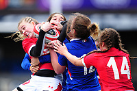 Lauren Smyth of Wales is tackled by Morgane Peyronnet of France during the Women's Six Nations Championship Round 3 match between Wales and France at the Cardiff Arms Park in Cardiff, Wales, UK. Sunday 23 February 2020