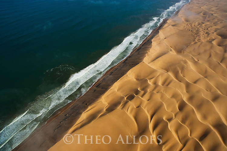 Namibia, Namib Desert, Skeleton Coast, aerial view of sand dunes and Atlantic Ocean
