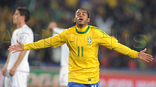 Robinho of Brazil celebrates after scoring during the 2010 FIFA World Cup soccer match between Brazil and Chile at Ellis Park Stadium on June 28, 2010 in Johannesburg, South Africa.